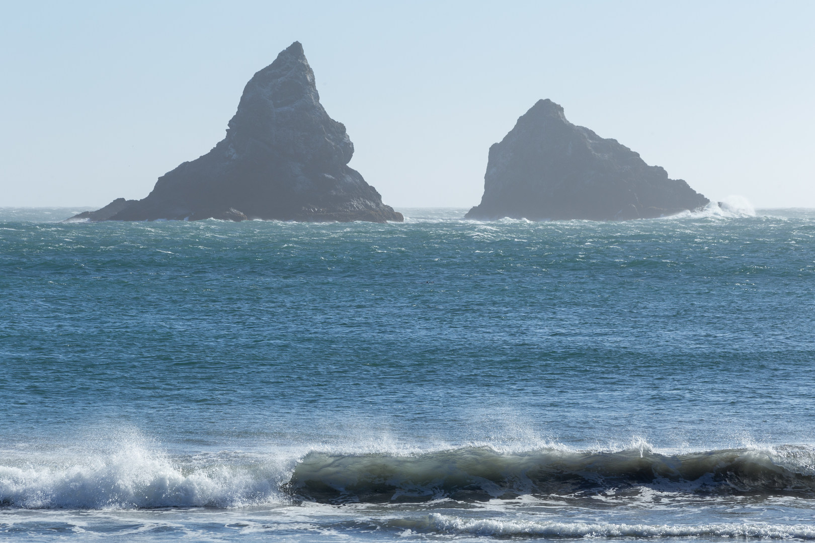 Lone A Wave Crashes At Ranch Beach With Jagged Sea Stacks In The Distance