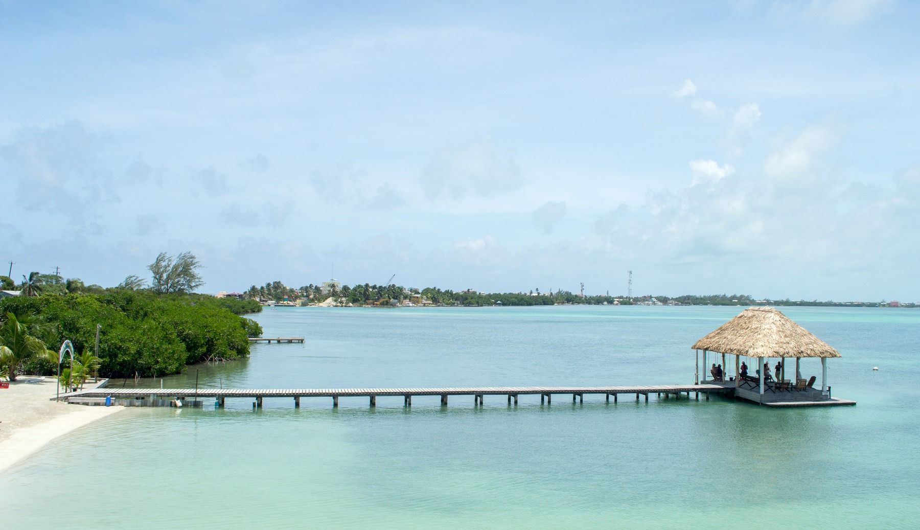 The Dock And Palpa Over Water Looking Back Toward South End Of Caye Koko King Beach