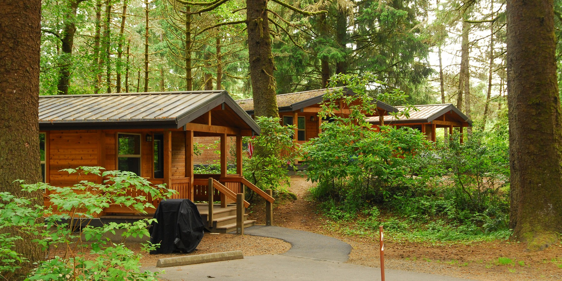 Very Impressive portraiture of Cabins at Fort Stevens State Park Campground.  14 Campgrounds Perfect  with #694114 color and 1600x800 pixels