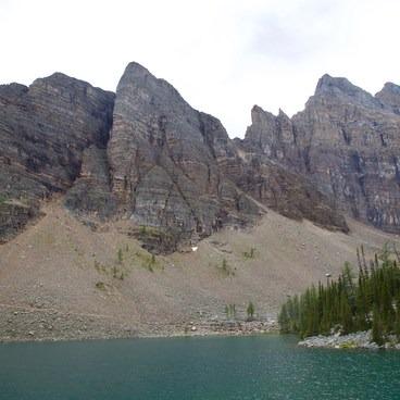 The Devil's Thumb (center) looms over Lake Agnes- Devils Thumb