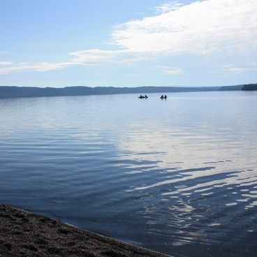 The objective: Tranquil Shoshone Lake. Actually the setting is tranquil but the lake often rough and commanding respect.- Lewis Lake to Shoshone Lake Loop