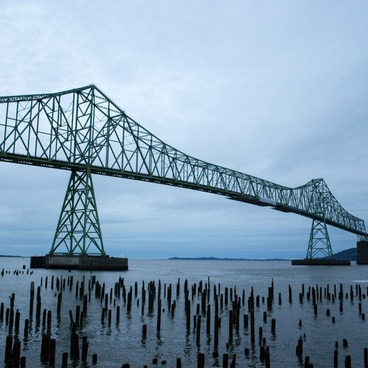 The Astoria–Megler Bridge over the Columbia River.- Astoria Riverwalk Trail