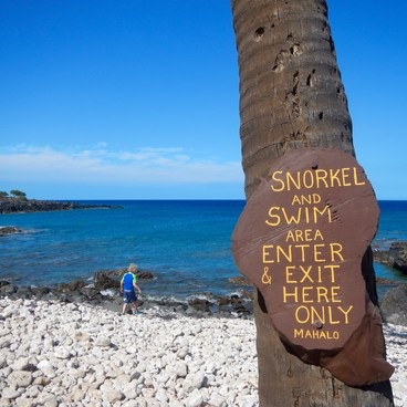 A sign clearly marks where you should enter the cove for snorkeling. - Lapakahi State Historical Park