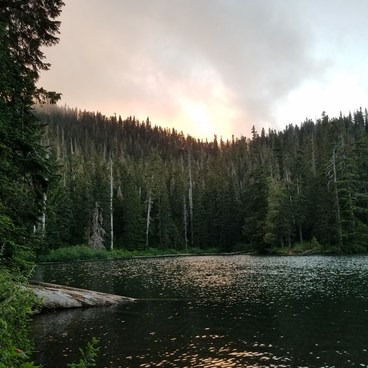 Sunset over the crater ridge as seen from the lake.- Soda Peaks Lake