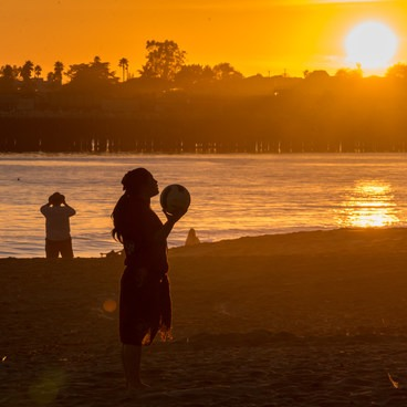A beach volleyball player enjoying the last moments of the day- Seabright Beach