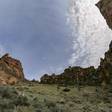 Hikers descending Misery Ridge and a slackliner on the Monkey Face.- Smith Rock, Misery Ridge Hiking Trail