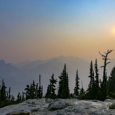 A smokey haze hangs over Cathedral Rock and Mount Daniel- Tuck + Robin Lakes