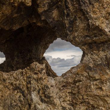 Cloud gazing through Needle Hole.- Pike Creek Mine Hike