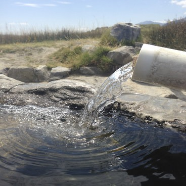 You can adjust the temperature by moving the pipe back into the stream- Shepherd Hot Spring