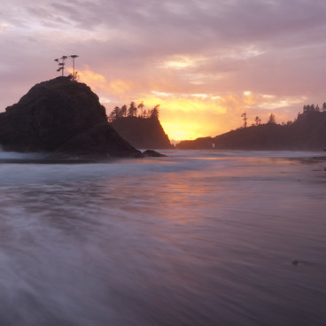 Waves rush in at high tide as the sun sets- La Push, Second Beach