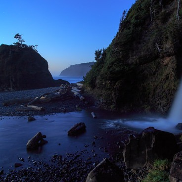 The runoff of the culver creates the look of an almost natural waterfall. Cape Meares in the distance.- Short Beach