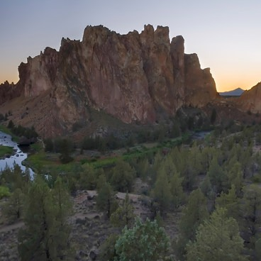 Smith Rock towers between the Three Sisters on the left and Mt Jefferson on the right- Smith Rock State Park