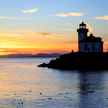 Visitors watch the sunset from the Lighthouse- San Juan Island, Lime Kiln Point State Park
