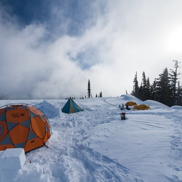 A significant camp setup with many expedition style tents.- Paradise Winter Campsites