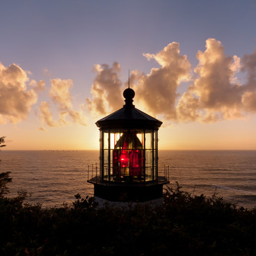 The sun behind Cape Meares lighthouse lights up the Fresnel lens- Cape Meares Lighthouse