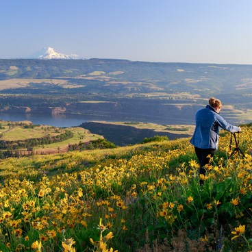 A photographer takes advantage of the early morning light- Tom McCall Point Hike