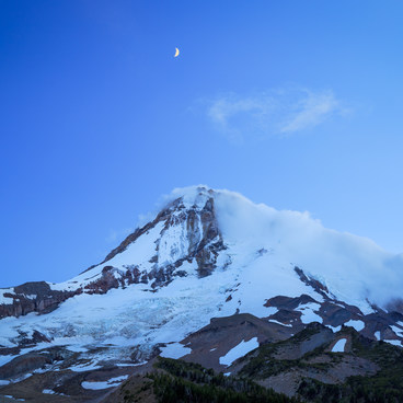Light fades during blue hour as the moon brightens above Mt Hood as seen from Cloud Cap- Cooper Spur + Cloud Cap Hike