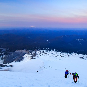 Loads of climbers making their way across the Triangle Moraine- Mount Hood South Route: Pearly Gates