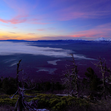 Beautiful sunrise over low lying fog and the Three Sisters from the trail on the southeast slope.- Black Butte Hike