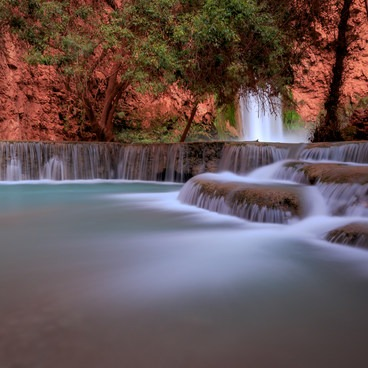 Havasu Creek cascades over impressive limestone travertines below Mooney Falls- Mooney + Beaver Falls Hike from Supai