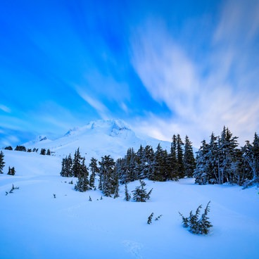 Long exposure of sweeping clouds over Mt Hood on a January morning- Mount Hood Wilderness