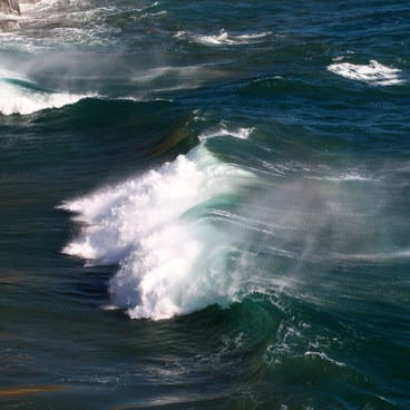 A wave crashes on the southern side of the beach- Pfeiffer Beach