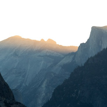 Light begins to bathe the High Sierra and half dome- Tunnel View