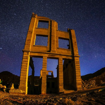 Awaiting the ghosts to emerge from this town beneath Nevada's dark nighttime skies!- Rhyolite Ghost Town