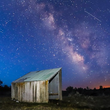 Milky Way and shooting star over West Valley Hot Spring.- West Valley Hot Springs