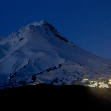 Mt Hood is a great backdrop... with the glow of Mt Head Meadows ski resort on it's slopes- Barlow Butte Hut