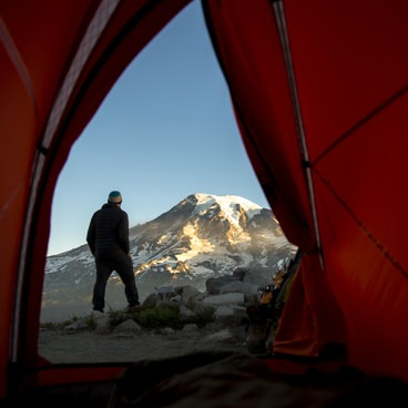 Tent view of Mt Rainier from a Tatoosh backcountry site- Unicorn Peak via Snow Lake