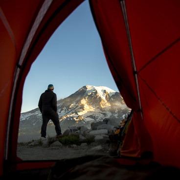Tent view of Mt Rainier from a Tatoosh backcountry site- Unicorn Peak via Snow Lake