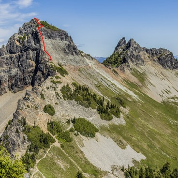 Pinnacle Peak (6,562 ft) in the foreground and The Castle (elev 6,460) beyond as viewed from Plummer Peak.  The class IV scramble up Pinnacle is noted in red.- Pinnacle Peak + The Castle