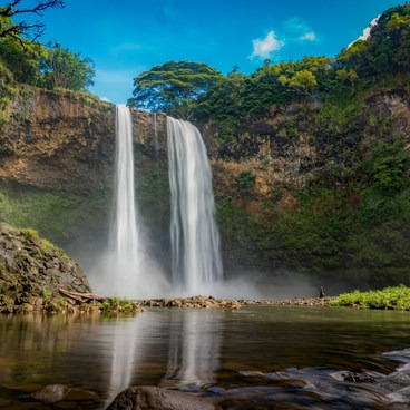 Early morning mist at the falls.- Wailua Falls