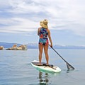 Enjoying a paddle in Coalition Sun's new gear.- Magic Happens with the Sisterhood of Shred