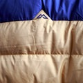 The mountainous details of the Kathmandu logo are quite unique.- Gear Review: Kathmandu Epiq Men's Hooded Down Jacket