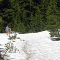 August snow pack on the trail.- Moraine Lake in the Three Sisters Wilderness