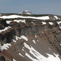 View across the rim. From left to right: Broken Top (9,177 ft), South Sister (10,358 ft), Middle Sister (10,047 ft) and North Sister (10,085 ft).- Tam McArthur Rim Hike