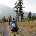 Backpackers en route to Broken Top's summit.  South Sister (10,358') in the background, shrouded in smoke.- Green Lakes