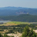 View looking south, with the lush meadow at Sparks Lake at center.- Broken Top Crater Hike