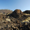 "View of Lava Butte with large ""snowballs"" in the foreground.- Lava Butte, Trail of the Molten Land"