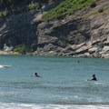 Surfers in Smugglers Cove.- Oswald West State Park