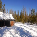 The former Swampy Lakes Sno-Park Shelter near the parking lot. This shelter was dismantled, and a new shelter is in place.- Swampy Lakes, Porcupine Snowshoe Loop
