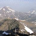 View looking down Broken Top's northwest ridge toward the Three Sisters.- Broken Top