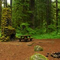 Campsite with historic chimney.- Camp Creek Campground