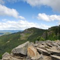 View from the summit looking east.- Mirror Lake + Tom Dick and Harry Mountain