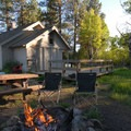 Outdoor dining and fire pit.- Cold Springs Guard Station