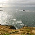 View south of Otter Rock and Devils Punchbowl State Natural Area.- Otter Crest State Scenic Viewpoint