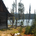 Historic cabin on Elk Lake's northern shore.- Elk Lake