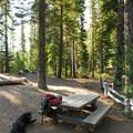 Picnic tables at the Tumalo Falls day-use area back near the parking lot.- Tumalo Falls + Creek Hike